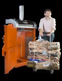 Orwak Compact 3110 cardboard bale and operator